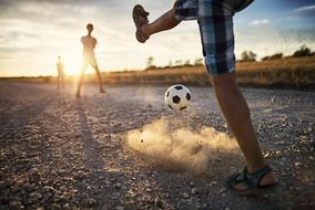 Join Australian high school students in a game of soccer while abroad.